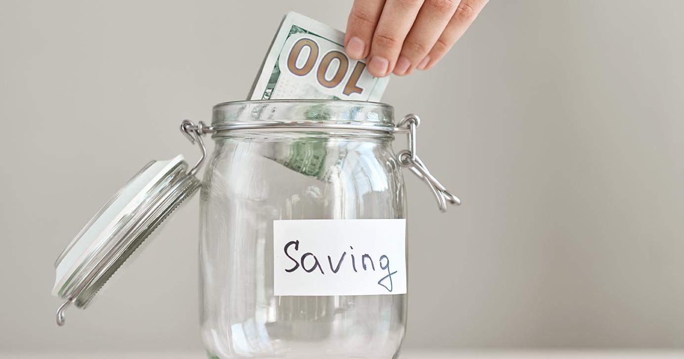 Putting Cash In A Glass Jar